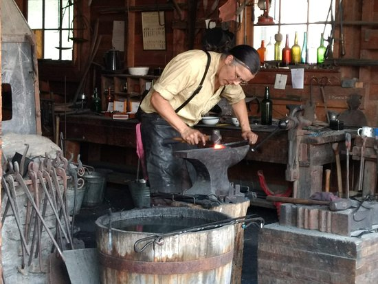 The Barkerville blacksmith hard at work.