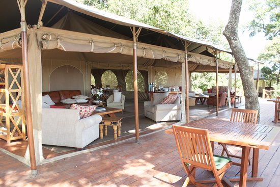 Rekero Camp, Asilia Africa: This is the community dining tent. The decor and furnishings are lovely and inviting.