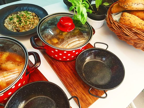 Delicious authentic dishes in lovely pots!