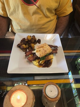 The Inn at Birch Wilds: Sweet Potato Biscuit with Ham and Gravy w/scrambled egg folded in with bacon and home fries!
