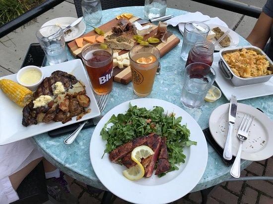 Homer, NY: Clockwise from top: Pub board, mac & cheese, Mediterranean tuna steak, Delmonico steak