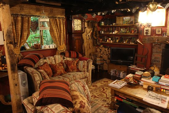 Wizards Thatch at Alderley Edge: part of the living room, Wizardry Suite