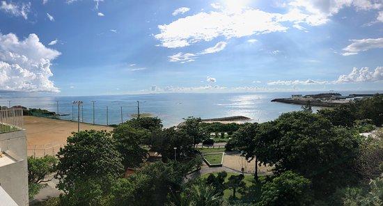 Yomitan-son, Nhật Bản: Sobe Beach Park - Community Center to left, Grassy park in front and Toya Port to right