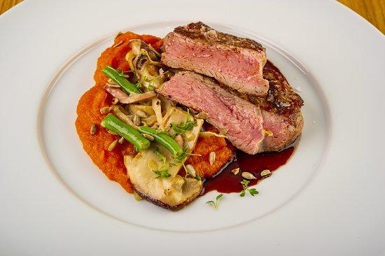 VEAL LOIN STEAK, mushrooms, bacon and green beans ragout, sweet potato purée, port wine sauce