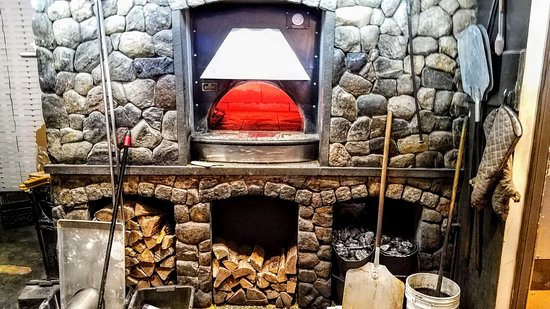 Ember Coal Fired Pizza & Wings: Where the magic happens, the pizza oven