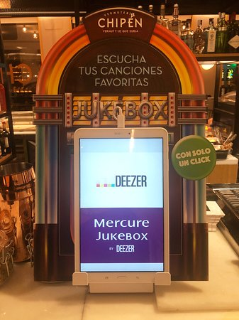 Your own mini-jukebox in the bar - Picture of Mercure Madrid Plaza