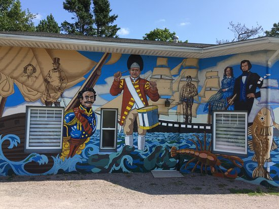 St. Martins, Canada: This historical mural was designed and painted by Muralist Fred Harrison.