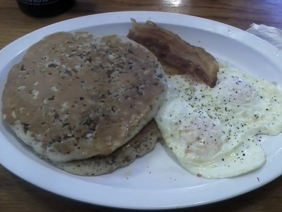Belleview, FL: pecan pancakes and eggs over easy, with bacon