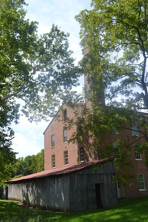 Lawson, MO: back side of the mill, the wood structure houses the steamboat boiler