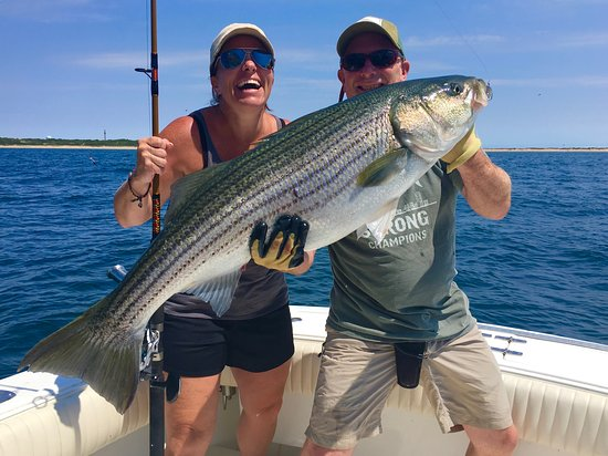 Truro, MA: The smile says it all. A trophy Striped Bass caught off Provincetown