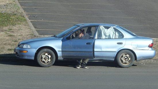 Money Saver Motel: Creepy guys living in a car