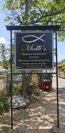 Malli's Seafood Restaurant sign board