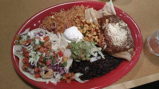 combo plate with tamale and fish taco
