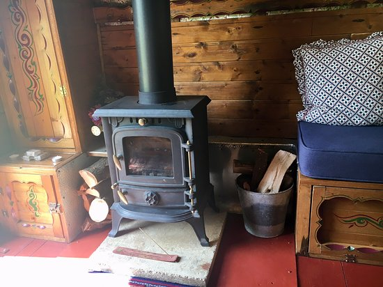 gypsy wood burning stove and seating picture of cotswolds camping