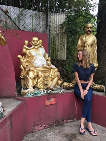 Ten Thousand Buddhas Monastery (Man Fat Sze): Siting next to a funny Buddha