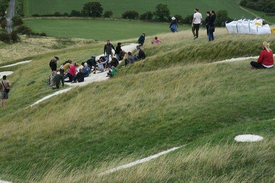 Uffington, UK: People scouring the White Horse.