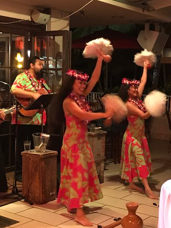 Tiki's Bar & Grill for great drinks, excellent food and views of the beach and music and hula show