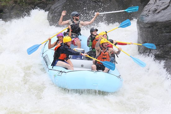 New & Gauley River Adventures: Gauley River Class V rapids, touching the rock