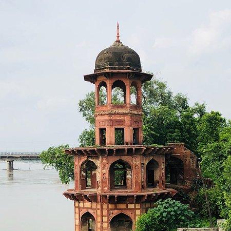 A quaint tomb beside the river