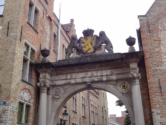 In Bruges Events - Day Tours: A typical Belgian Arch between Buildings