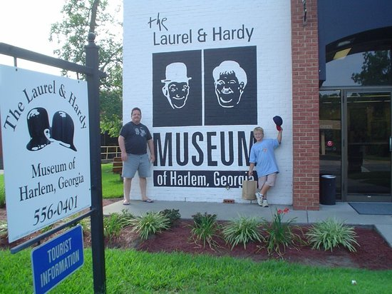 The Laurel and Hardy Museum of Harlem, Georgia: Me and my son at the front of the museum.