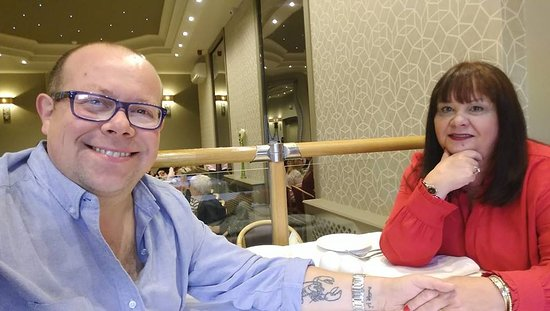 Chester Moor, UK: My wife and I seated at our table in Le Raaj. I'm the one with the lobster tattoo on my arm.