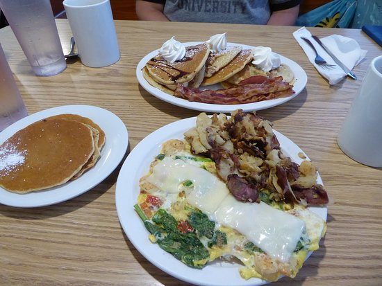 Kate's Pancake House: my trio of pancakes on the other side.. bacon was yum also!