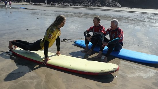 Surf's Up Surf School: Classic on-beach instruction pose!