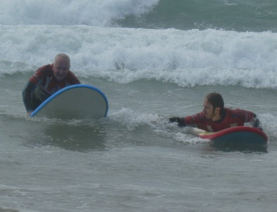Polzeath, UK: Father and son getting to grips with the basics