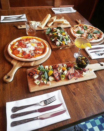 Pizzas, Bread and Butters, Antipasti and Goats Cheese and Walnut Salad
