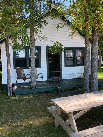 Cedarville, MI: Front porch and picnic table of cabin 7