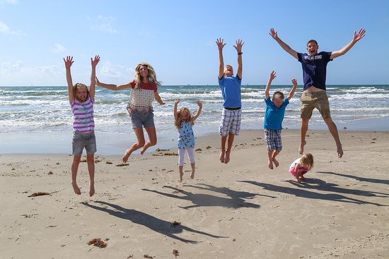 Port Royal Ocean Resort & Conference Center: Family on Mustang Island beach behind Port Royal