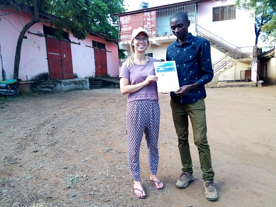 Africa Natural Tours: she is happy to get a certificate of the mountain climbing