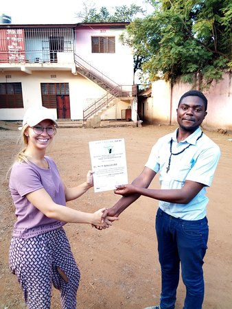 she is happy to get a certificate of Africa Natural Tours