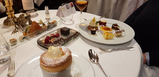 Le Gavroche: Two desserts - one a passion fruit souffle. the other a selection of the chef's favourites