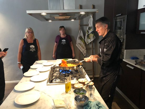 Extra Virgin Cooking Classes: Giuseppe heating our gnocchi in a tomato sauce