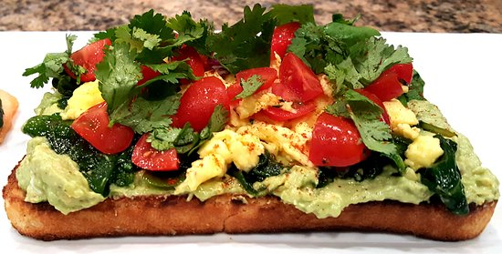 Linwood, NJ: Barista's avocado Toast with sauteed spinach, tomato, scrambled egg