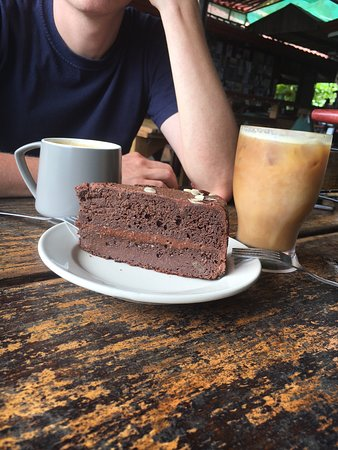 Vegan chocolate cake, iced coffee and cappuccino with almond milk