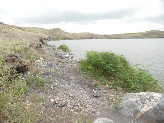East Kazakhstan Province, Kasachstan: shore of lake, with evidence of campers