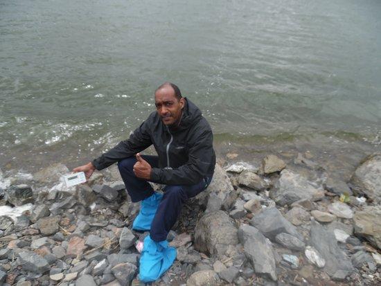 Lake Chagan: sitting on stones next to the lake