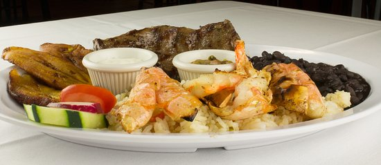 A Combination of Skirt Steak, 3 Grilled Giant Shrimps, Sweet Fried Plantains served with Black B