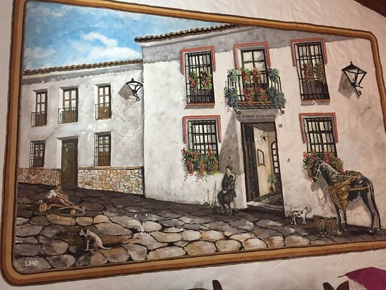 El Gastor, Spanien: The painting on the wall showing the posada in the 1800s