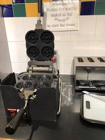 The breakfast buffet waffle iron is cute