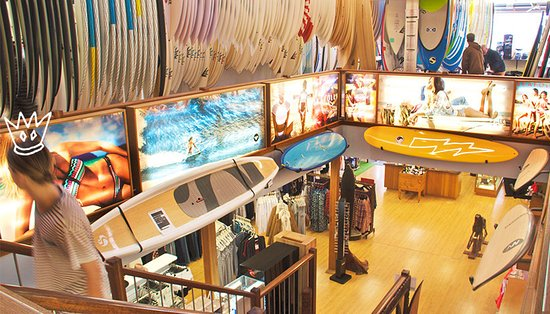 Gerringong, Australia: Looking down the stairs, over the huge range of surfboards.