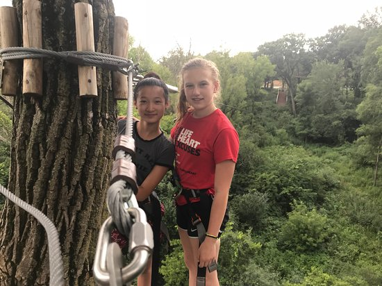 Western Springs, IL: This is a picture of my daughter and her friend in front of the biggest and final zipline