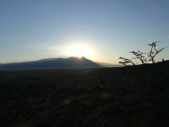 Sanya Juu, Tanzania: 6:30 am - sun up behind the Kilimanjaro