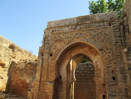 Chellah: An ornate archway in the ruins of the mosque.