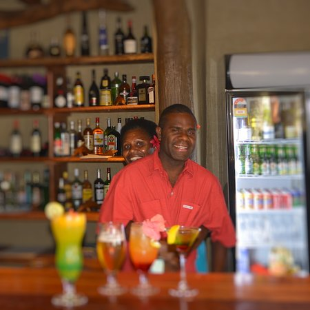 Jimmy and Nawiwa fooling around behind the bar ..the girls love him, but he is happily married m