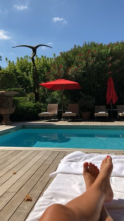 Sitting by the pool at Villa Gallici.