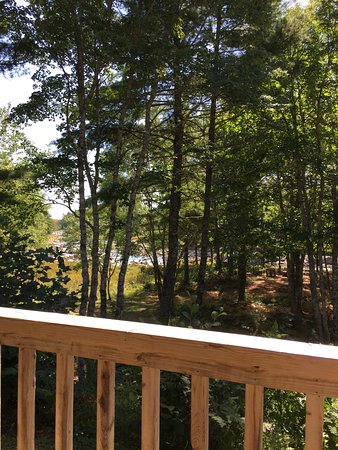 Roseway River Cottages: deck has a bbq, chairs and table